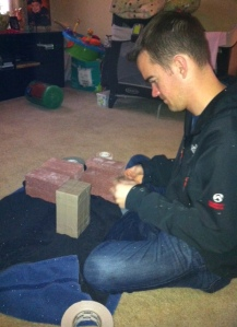 Here is my husband, wrapping his bricks for our challenge.